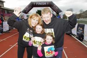 Colin McCredie and family celebrate as the cross the line for the Inverness 5K.