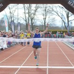 Inverness Half marathon winner (1:05:39), Andrew Douglas crosses the line. Picture: Paul Campbell/Inverness Half Marathon 2016
